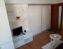 Obývací stěna_Bílá lesk SE2HG_Úchytový profil Bílá lesk